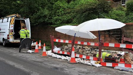 Repair work is under way in Back Lane, Melbourn. Picture: Clive Porter