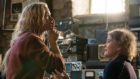 Left to right: Emily Blunt plays Evelyn Abbott and Millicent Simmonds plays Regan Abbott in A QUIET