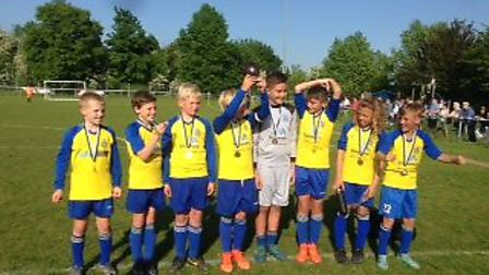 St Albans City Youth U11 Orient celebrate their cup success.