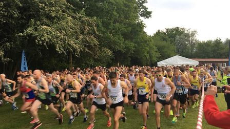 Runners charge away from the start of the Midweek Road Race League in St Albans.