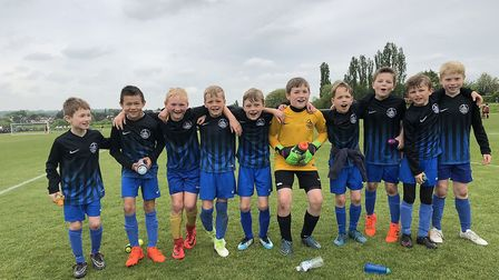 St Albans City Youth U9 West celebrate their cup success.