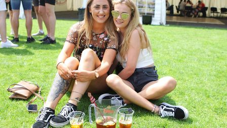 Georgina Williams and Briony Edwards enjoy drinking Pimm's at the festival in Garden Walk.Picture