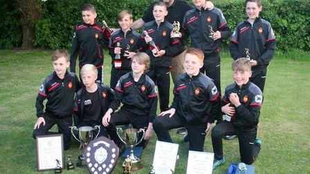 Hemingford Colts Black Under 12s show off their silverware.