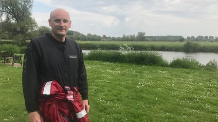 Firefighter Paul Whittaker at the river where Roby John drowned.