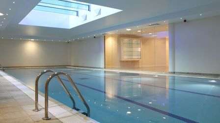 Features include an indoor heated pool