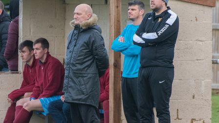 Mark Spavins (standing, left) while in charge of Eaton Socon last season. Neil Morris (blue top) wil