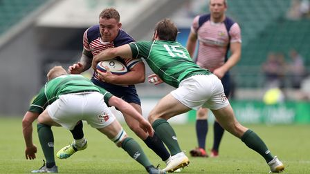 Lancashire's Phil Mills (second left) is tackled by Hertfordshire's Sean Taylor (right) and James Re
