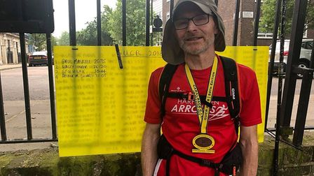 Patrick McGuinness and the Wall of Fame after he completed the Grand Union Canal Race.
