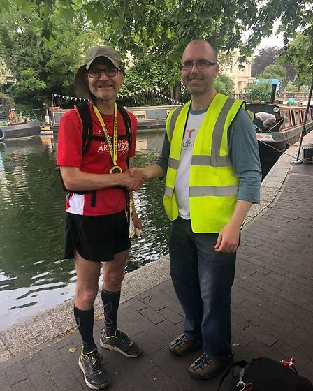 Patrick McGuinness is presented with his finishers medal for completing the Grand Union Canal Race.