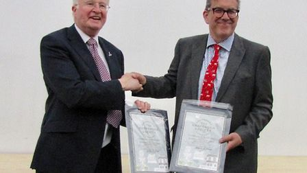 On the left is Harpenden Society chair Phil Waters and on the right is Lawes Agricultural Trust chai