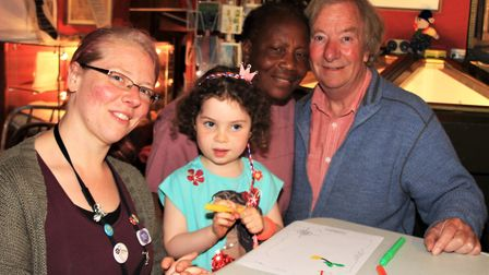 Esme, with grandparents Mary and Brian who are helping her to make a treasure map. Picture: Clive Po