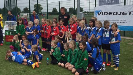 The teams who took part in the Under 8 girls category are pictured with Stuart Pearce.