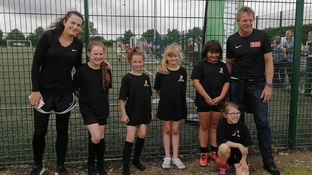 Stuart Pearce pictured with the newly-formed Somersham Town Under 9 girls side.