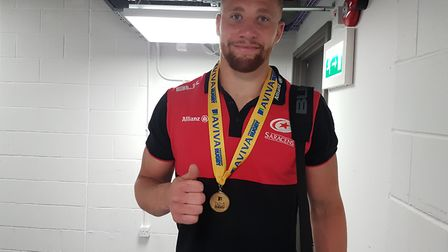 St Albans' Nick Isiekwe shows off his winners medal after Saracens 27-10 win over Exeter Chiefs in t