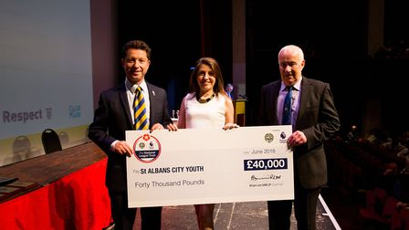 St Albans City Youth Football Club's Lawrence Levy and Geoff Watts receive the cheque from St Albans
