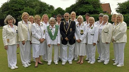 The Hunts women's team are pictured with English Bowling Federation president Trevor Harris ahead of