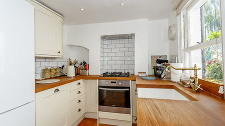The kitchen has a Belfast sink and a full size dishwasher