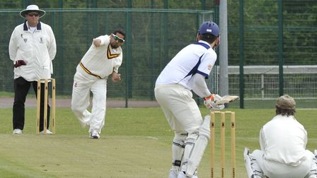 Skipper Navid Ahmed took three wickets as Huntingdon & District beat Blunham to go top of Whiting &