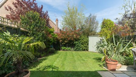 The neat and tidy rear garden faces west