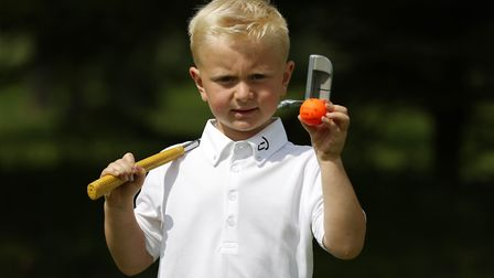 Marcus Karim, four, with the ball which he hit a hole in 1 with at Kingsley Golf centre. Picture: CA