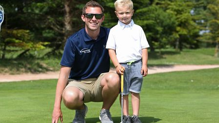 Marcus Karim, four, with his coach Kingsley Golf centre PGA professional Chris Hattersley. Picture: