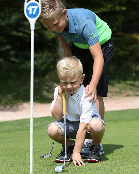 Lewis, nine, and brother Marcus Karim, four, at Kingsley Golf centre. Picture: CALLUM ALLCOCK-GREEN