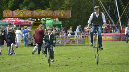 David Loose and son William on the Penny Farthings