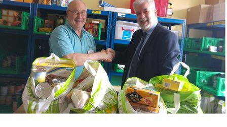 Huntingdon branch manager Alastair Smith hands over food donations to a food bank