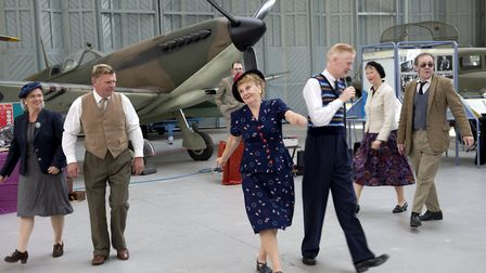 Living history groups representing American and British air force personnel and ordinary civilians a