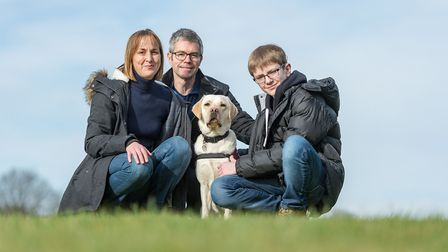 Oscar Williamson with his family and guide dog Rosie.Picture: Paul Williamson