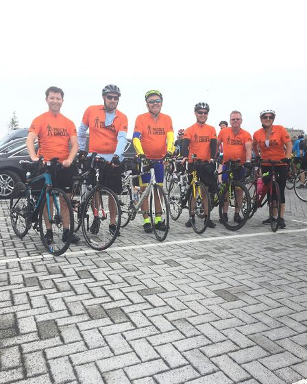 The riders with orange Prostate Cancer UK jerseys.
