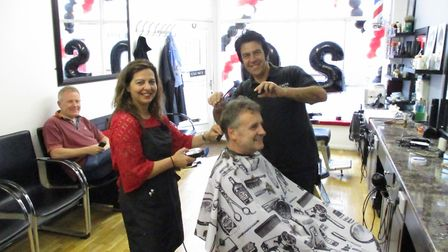 Carmelina and Vince Citrano cutting a customers' hair.