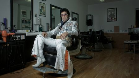 Vince Citrano dressed as Elvis in his barber shop on Catherine Street.