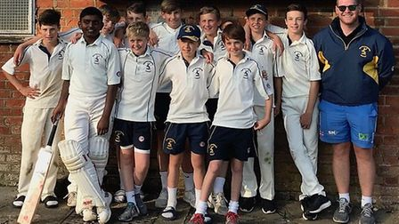 Hunts Under 13s celebrate their victory against Hertfordshire with coach Lee Smith.