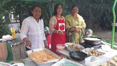 Syeda (middle) and members of the Hertfordshire All Women's Trust at the Larks in the Park event at
