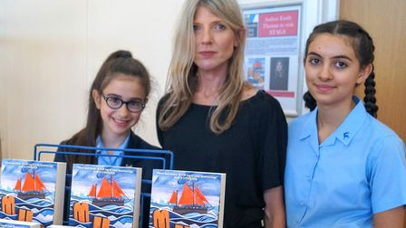 Author Emily Thomas (centre) with two STAGS pupils.