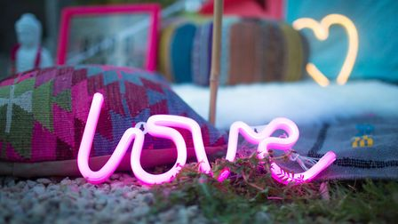 Put passion into the patio: Love LED neon light sign - pink, £14.99, Boutique Camping. Credit: Talki