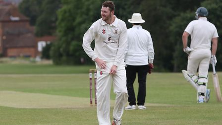 Harpenden's Tom Beasley prepares to bowl in the match between Harpenden and Letchworth. Picture: DAN