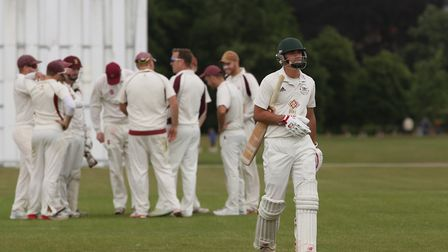 Letchworth Garden City's Tom Simmons walks off after losing his wicket against Harpenden in the matc