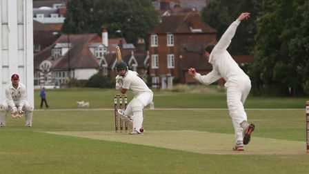 Letchworth Garden City's Tom Simmons faces a delivery from Harpenden's Tom Beasley in the match betw
