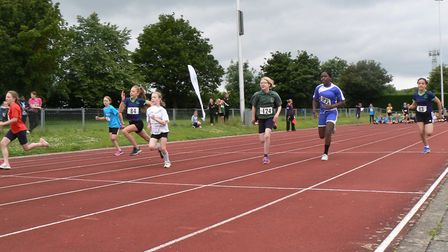 Runners take part in a 75m sprint race during the Quadkids Athletics Competition.