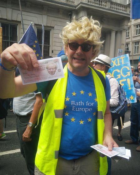 """The infamous Boris Johnson imitator, giving out """"Brexit dividends"""" during the protest."""
