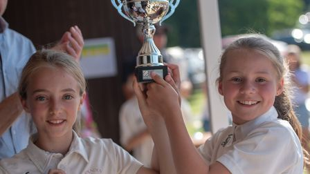 Winning co-captains Abi Wright and Abbie Hitchen pick up the trophy. Picture: Fiona McCarthy Photogr