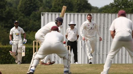 Harpenden's Tom Beasley bowls in the match between Radlett and Harpenden. Picture: DANNY LOO