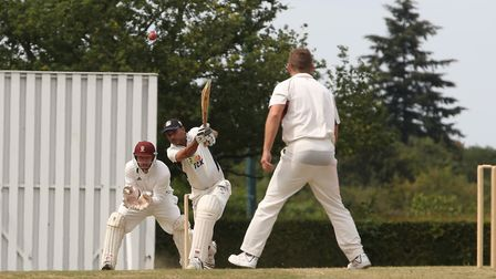 Radlett's Fakir Dungaria hits a boundary from Harpenden's Ben Clements bowling in the match between