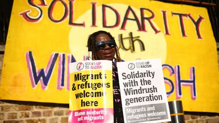 A campaigner at an event organised by Stand up to Racism in solidarity with the Windrush generation