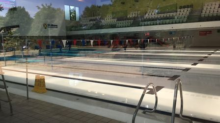 Westminster Lodge with a cover over the pool and hazard cones on the side.