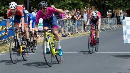 Verulam Reallymoving's Matt Watson takes the win in the U16 race at the Fete du Velo in Redbourn. Pi