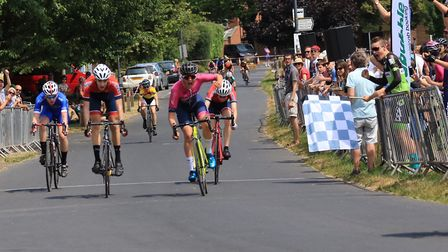 Verulam Reallymoving's Matt Watson takes the win in the U16 race at the Fete du Velo in Redbourn.