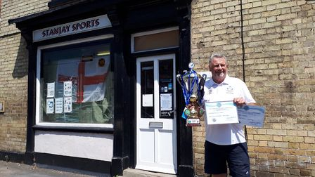 Stan Binge shows off his honours outside his Stanjay Sports and Trophies shop in Godmanchester. Pict